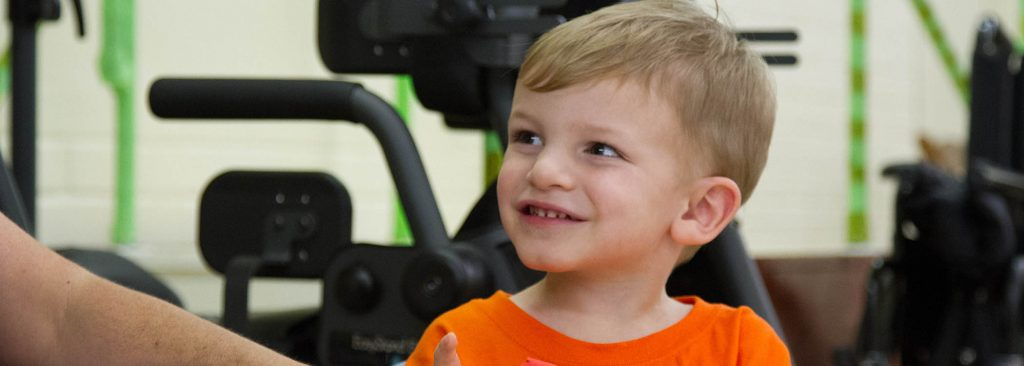 photo: young boy in wheelchair waiting to receive therapy